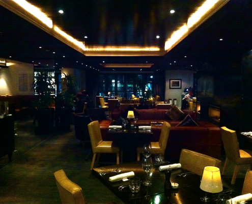 Leather chairs, booths, fireplace, cowhide